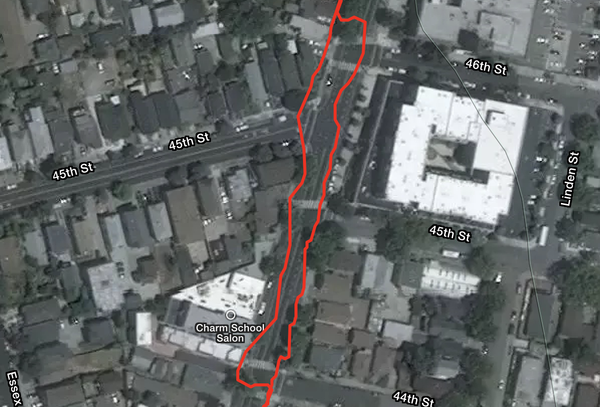 GNSS track of a Suunto 9 crossing a road overlaid on a satellite image